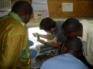 CEO and co-founder, Dr. Erik Douglas demonstrating the CellScope prototype for health workers in Goma.