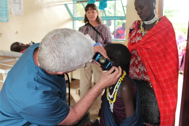 Dr. Powell examining the ear of a young Maasai child in Tanzania.